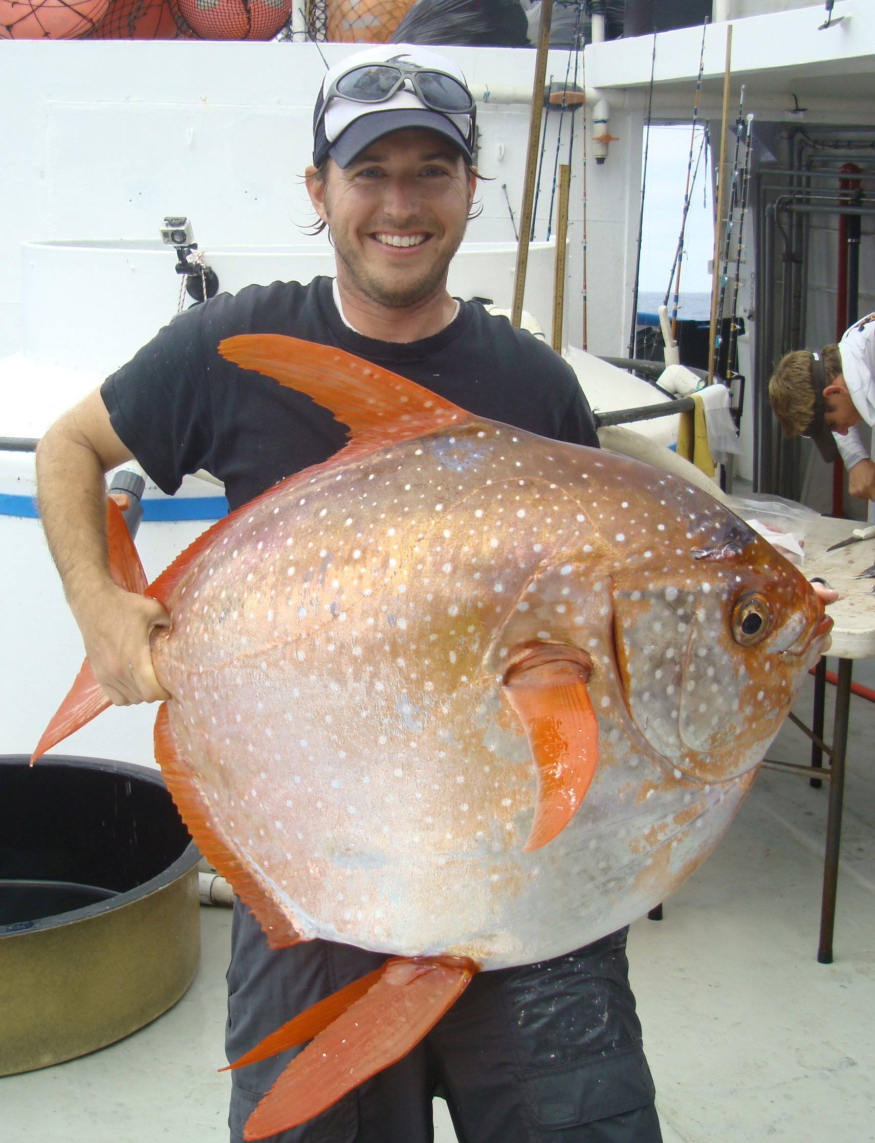 US NOAA biologist Nicholas Wegner holding an opah fish (credit: NOAA Fisheries/Southwest Fisheries Science Center)