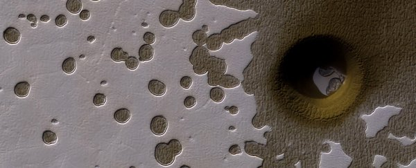 NASA couldn't explain what made this strange, deep hole on Mars