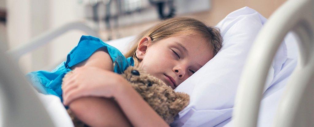 Girl with teddy sleeping hospital getty 1024