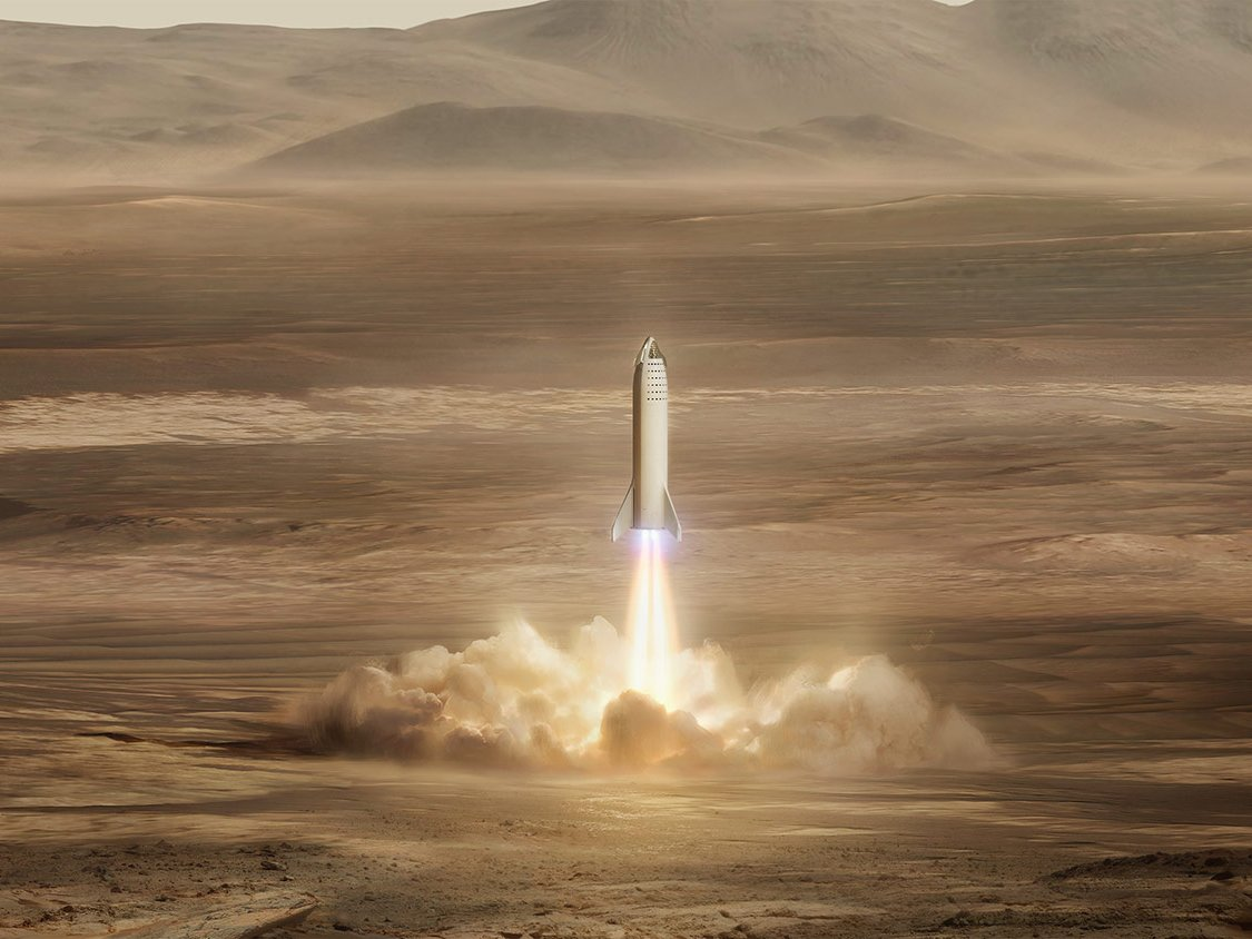 An illustration the Big Falcon Rocket landing on Mars. (SpaceX)