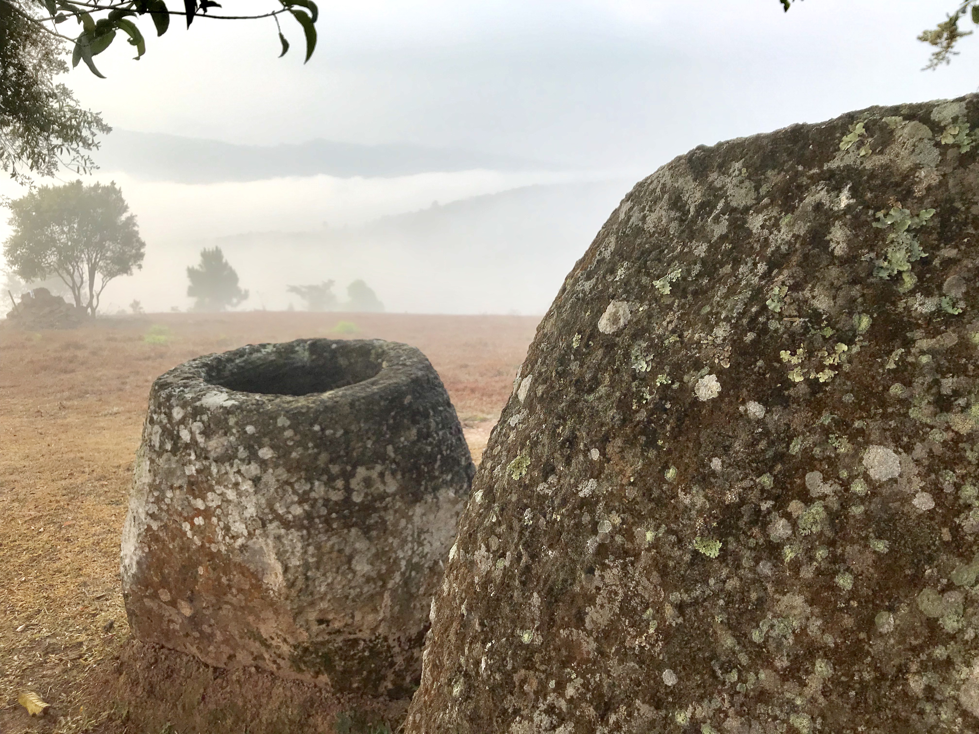 Mist day at Site 2 showing two sandstone megalithic jars