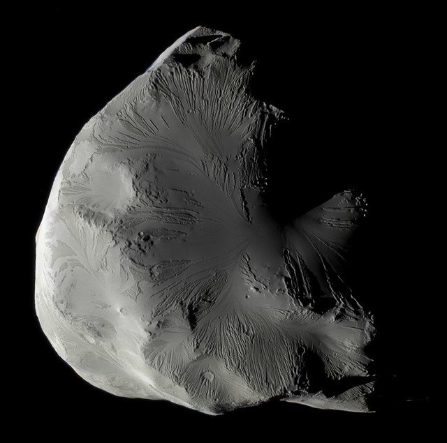 Not all of Kevin's work is on Jupiter. This is Saturn's moon Helene captured by the Cassini spacecraft. (NASA/JPL-Caltech/SSI/CICLOPS/Kevin M. Gill)