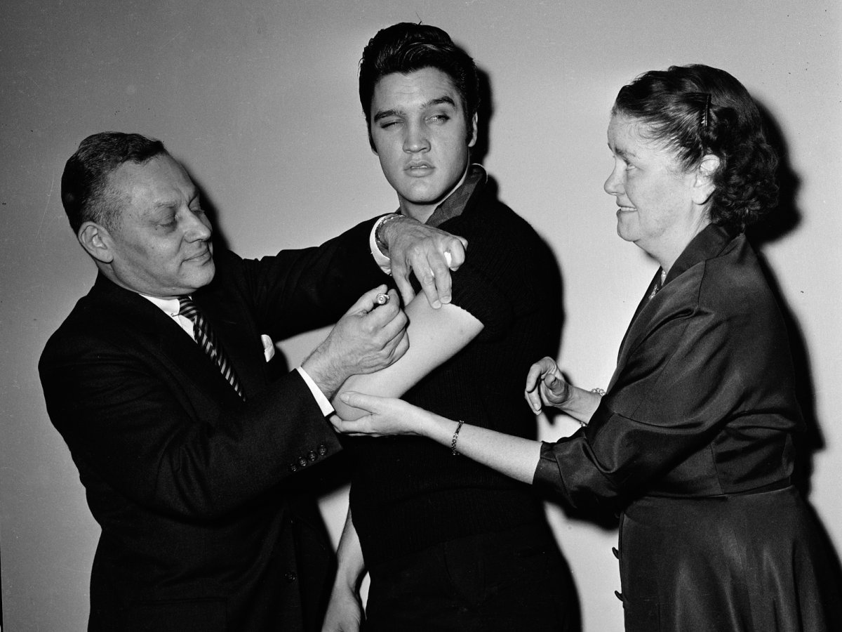 Elvis Presley getting a polio vaccine backstage at the 'The Ed Sullivan Show' in New York in 1956. (CBS Photo Archive/Getty Images)