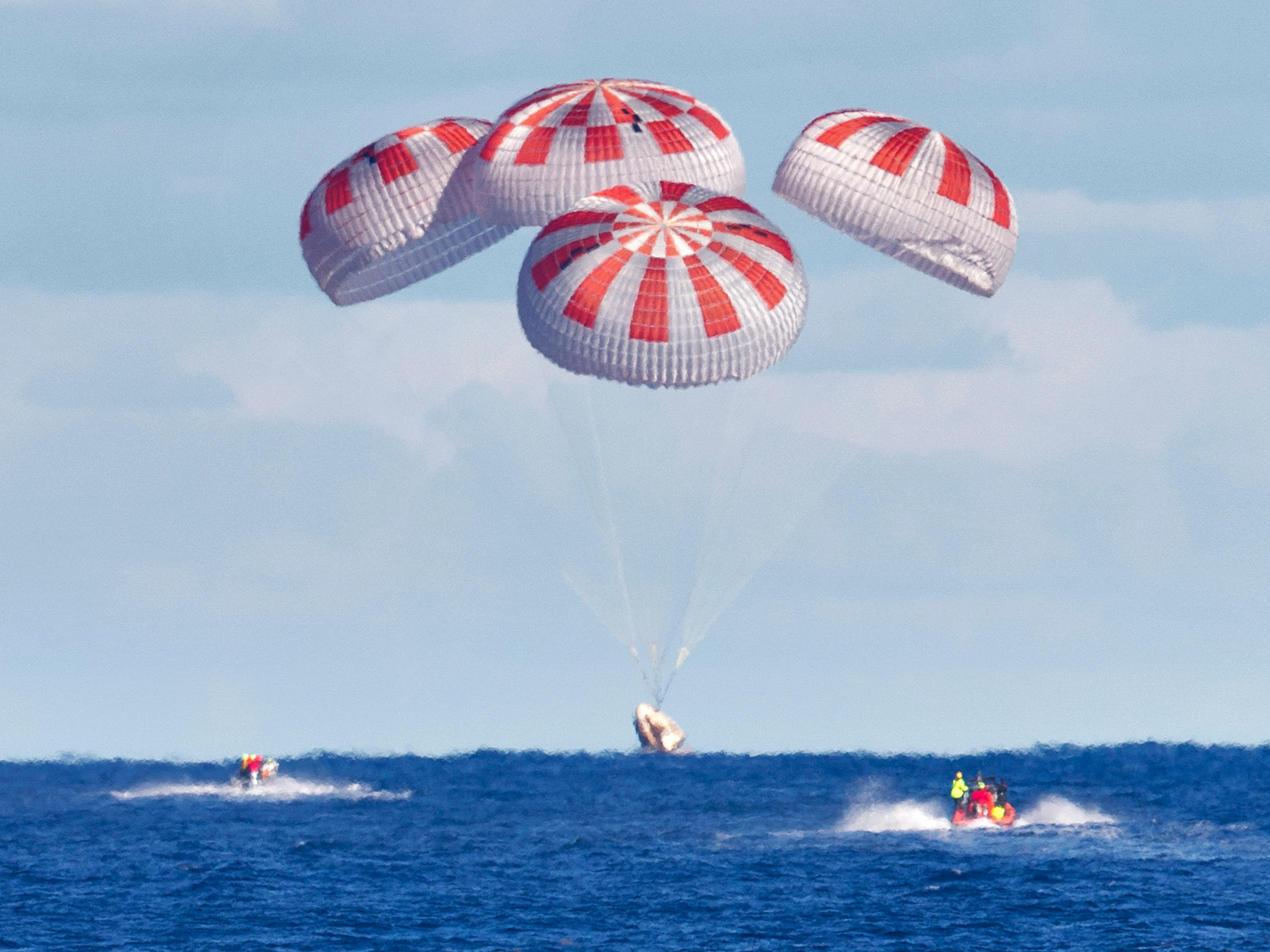 SpaceX's Crew Dragon uses four parachutes for a splashdown, March 2019. (Cory Huston/NASA)
