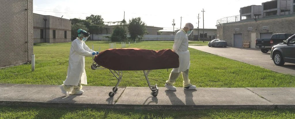 Medical staff with a deceased patient on June 30 in Houston, Texas.
