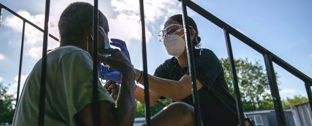 A medic provides oxygen to a patient in Houston, Texas on August 14.