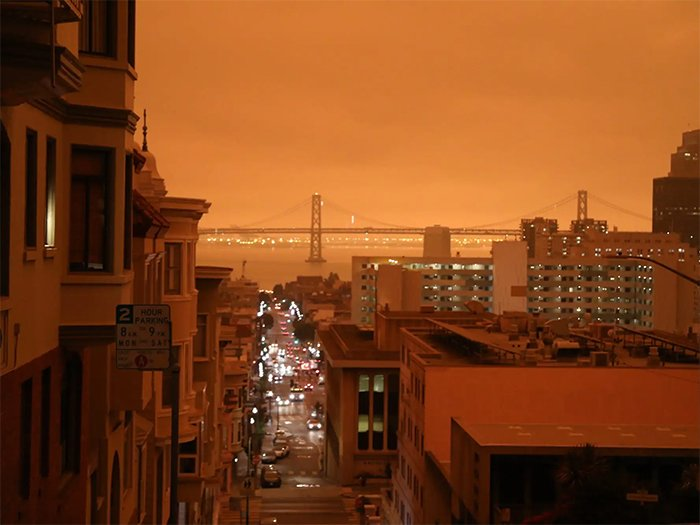looking at the bay bridge with red skies