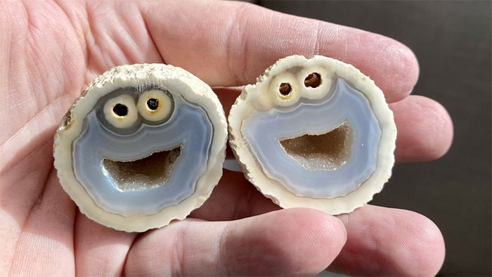 Agate rock cut in half to reveal cookie monster's face