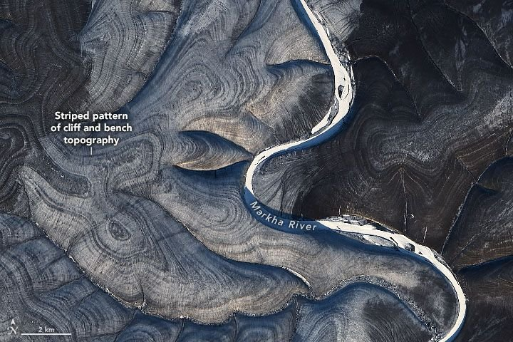 The striped swirls have scientists perplexed. (NASA Earth Observatory/ Landsat 8)
