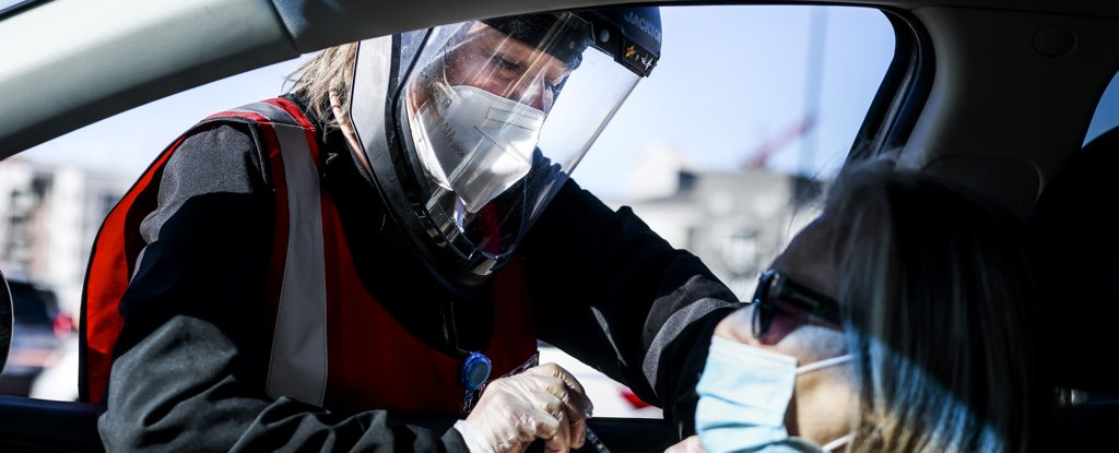 A nurse administers a vaccine on 30 January 2021 in Denver, Colorado.