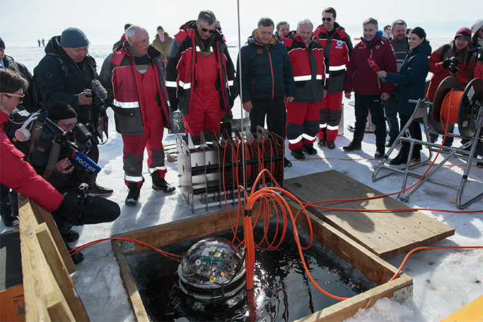 Scientists launching Baikal Gigaton Telescope into a lake