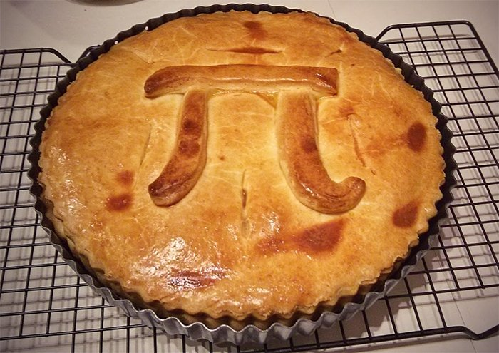 A baked pie with the pi symbol on top