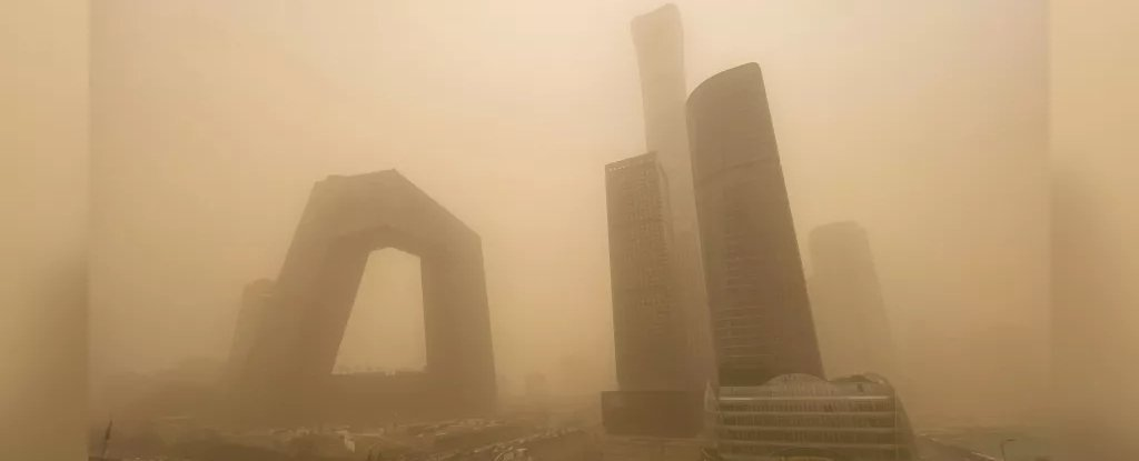Beijing's CBD buildings disappear from view behind the airborne sand.