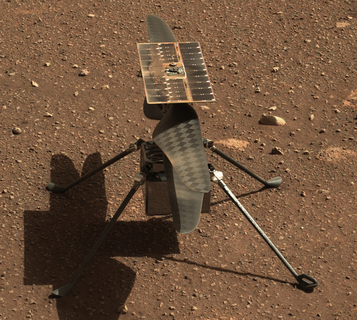 A photograph of the helicopter Ingenuity on the surface of Mars.