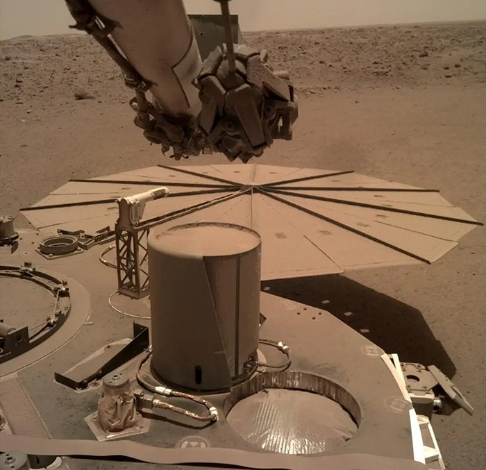 Insight on mars covered in a layer of dust