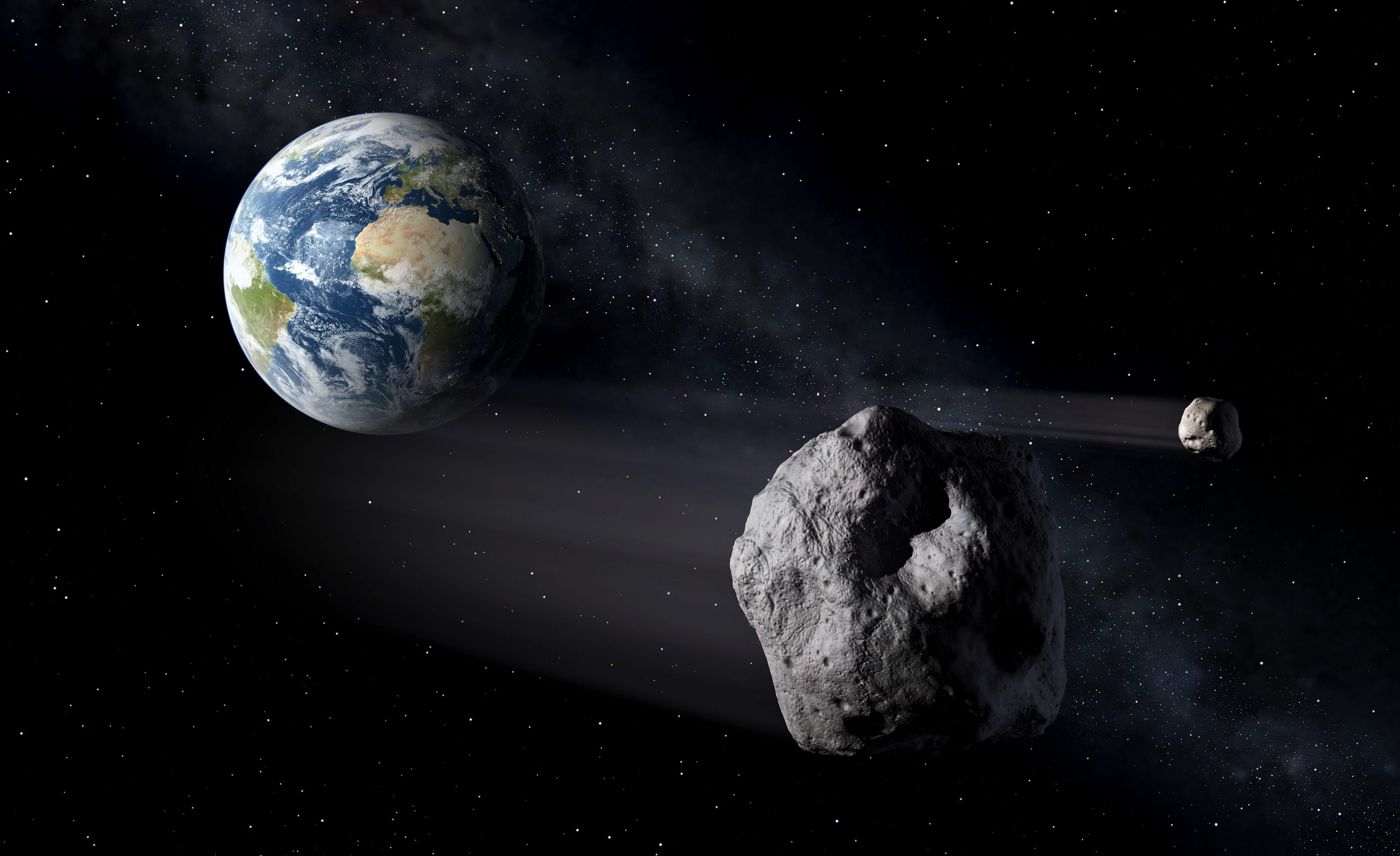 An artist's illustration of asteroids flying by Earth. (Peter Carril/ESA)