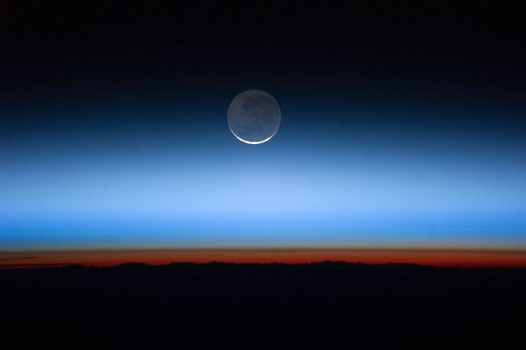 Earth's atmospheric layers: troposphere (orange-red) and stratosphere (blue) as viewed from the ISS. (NASA/JSC Gateway to Astronaut Photography of Earth)