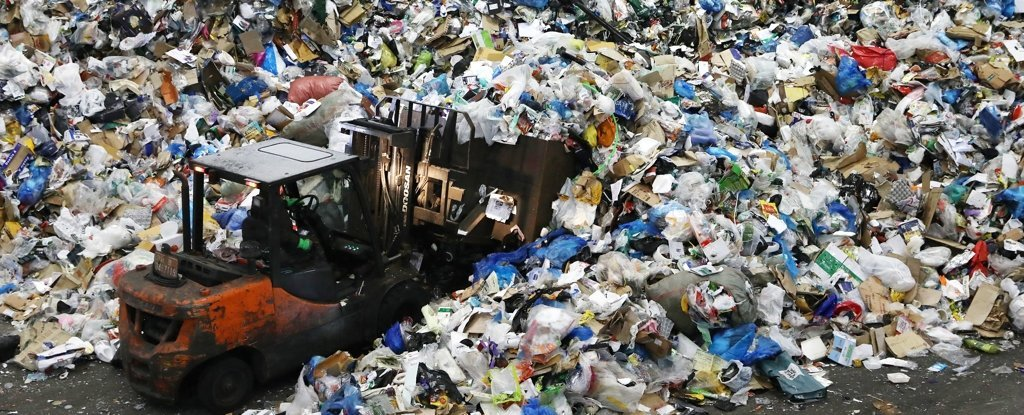 A worker moves household waste in Seoul, February 2021.