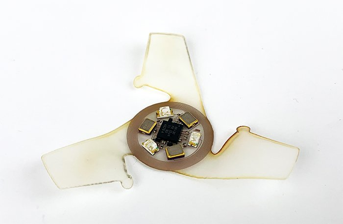 Round microchip-like device with translucent wings