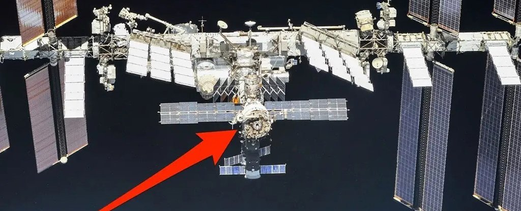 The International Space Station with an arrow pointing to the Zvezda Module.