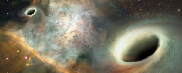 Orbiting supermassive black holes have been observed for the first time