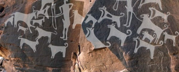 This 8,000-year-old rock art is the earliest depiction of domesticated dogs