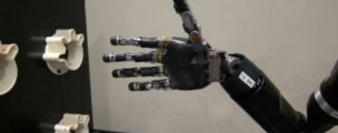 WATCH: New mind-controlled robot arm grabs and moves objects