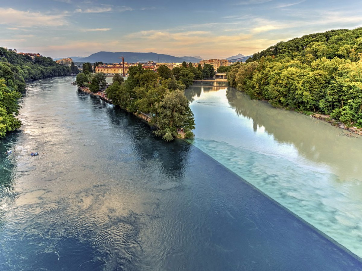 in-geneva-travelers-can-witness-the-majestic-sight-of-two-rivers-colliding-with-one-another-the-rhone-river-starts-in-lake-lehman-while-the-arve-river-is-fed-by-glaciers-in-the-chamonix-valley-when-the-two-bleed-into-one-another-it-makes-fo