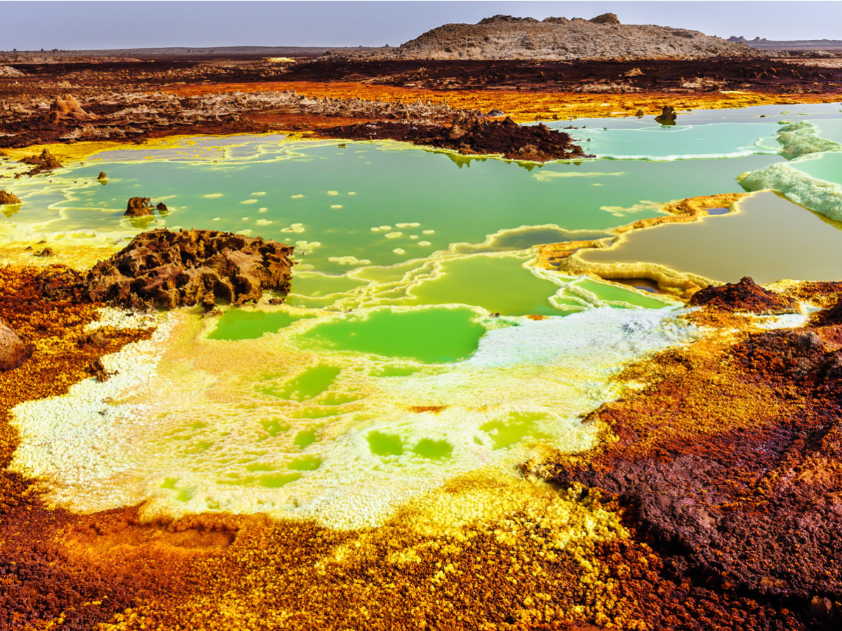 the-danakil-depression-in-the-northeastern-corner-of-ethiopia-is-one-of-the-hottest-places-on-the-planet-with-temperatures-reaching-as-high-as-145-degrees-fahrenheit-with-two-active-volcanoes-a-bubbling-lava-lake-geysers-acid-ponds-and-seve