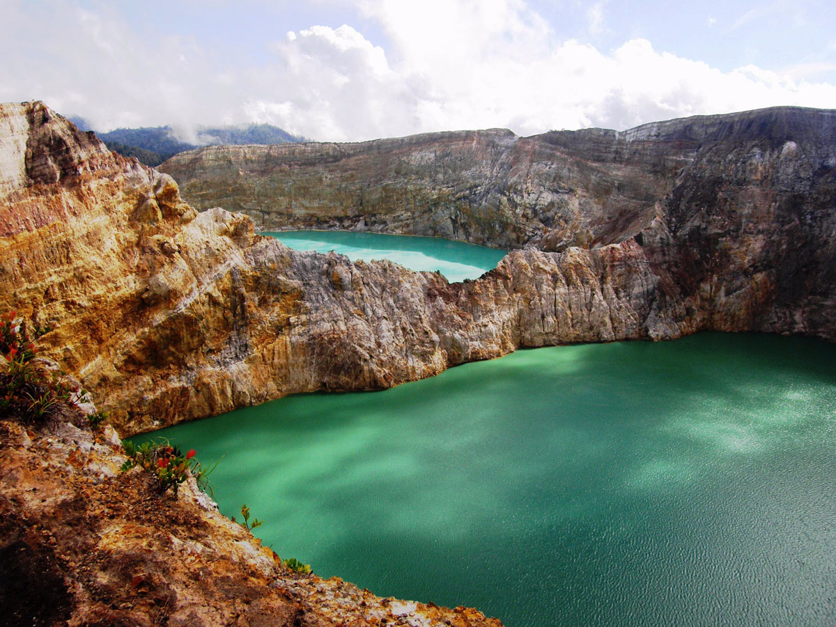the-kelimutu-volcano-on-flores-island-indonesia-is-home-to-three-colored-lakes-ranging-from-turquoise-to-a-rich-green-the-lakes-are-incredibly-dense-adding-to-the-striking-appearance-of-their-colors-which-are-thought-to-be-caused-by-dissolv